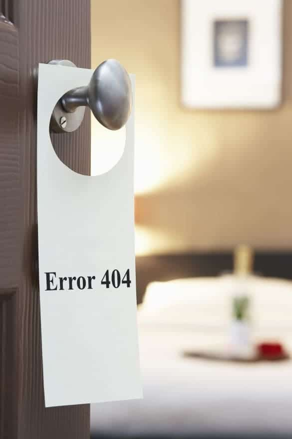 Error 404' sign on hotel room door