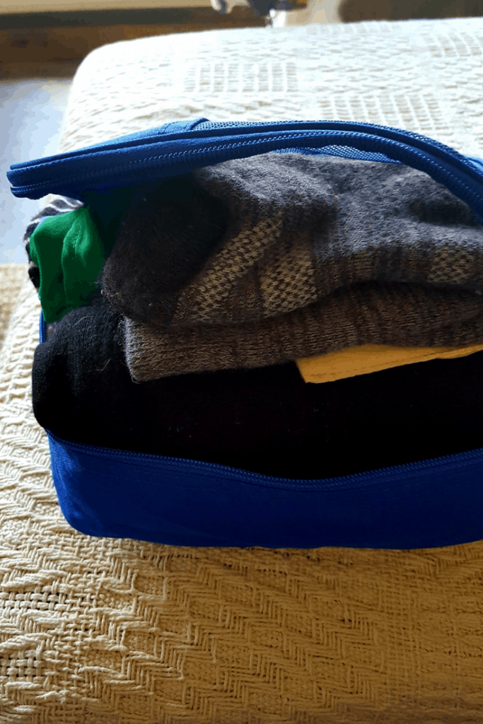 Learn how to pack light in carry on luggage only. #travel #traveltips #carryon #luggage #packing